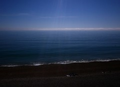 Fog bank visible off Seatown, Dorset, England (a.pierre4840) Tags: england seascape beach fog lumix panasonic lensflare dorset vignetting seatown 14mm highdynamic artfilter gm1