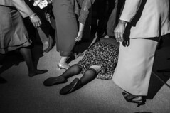 Falling Out #2 (Ben Helton) Tags: family blackandwhite bw white black church monochrome project photography photo store hands women worship photographer legs ben storefrontchurch african candid flash documentary indoor front christian american bible messiah praise supporting blackchurch senoia helton africanamericanchurch wwwbenheltoncom praisebreak