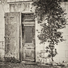It's just an empty chair (Peter Jaspers) Tags: door blackandwhite bw stilllife france tree texture monochrome square french blackwhite chair zwartwit antique decay streetphotography olympus paca panasonic luberon omd alpesdehauteprovence 2016 blancetnoir forcalquier 500x500 em10 streeflife silverefexpro monochromemonday 20mm17 frompeterj