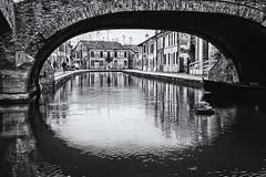 Covered parking (Alessio Pagani) Tags: barche boats boat canale canal comacchio ponte bridge town paese acqua water riflessi riflesso riflettere biancoenero black white
