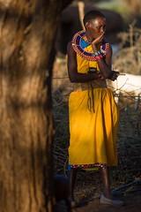 Maasai Woman - Il Ngwesi Cultural Boma (Christopher J May) Tags: africa light portrait woman tree kenya maasai goldenhour ilngwesi nikond800 nikonnikkorafd80200mmf28 nikonafnikkor80200mmf28d culturalboma