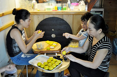 Trying to help (Roving I) Tags: cooking cakes boys children cuisine mothers vietnam grandchildren shops grandmothers danang productionline rollingpins hairbuns