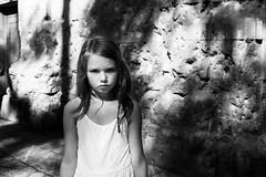 Girl and shrapnel marks (B. Wurzinger) Tags: girl shrapnel marks plaadesantfelipneri barcelona