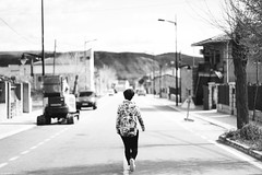 (Isa_IQV) Tags: street people bw españa blur girl canon person calle spain alone chica gente wb soledad desolation
