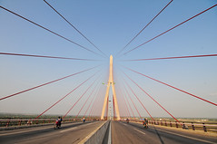 Can Tho cable-stayed bridge in Vietnam (phuong.sg@gmail.com) Tags: road city travel bridge blue light sky building tower lamp metal architecture modern river concrete design big high construction highway asia view cross traffic suspension outdoor path steel south transport large engineering delta cable landmark can structure vietnam clear viet transportation infrastructure hanging tall suspended longest mekong nam stayed cantho tho cablestayed