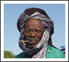 L'homme au cure-dents -  The man with toothpicks (diaph76) Tags: africa portrait man glasses toothpick turban lunettes homme afrique sénégal curedents