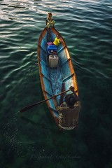 Paddle it home. (Syahrel Azha Hashim) Tags: ocean poverty travel light vacation holiday seaweed detail kids 35mm children prime colorful southeastasia dof getaway sony details paddle naturallight malaysia handheld editorial local shallow supplies woodenboat simple paddling unfortunate clearwater humaninterest simplelife seagypsies a7ii colorimage denawanisland sonya7 syahrel ilce7m2
