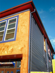 Colorful House (stefanws) Tags: california red orange house building window colors yellow wall architecture happy paint perspective sunny cheerful multicolored trim vallejo faade stucco clearsky vibrantcolor residentialbuilding