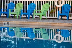 Mirrored (Joanne Dale) Tags: blue reflection green water pool lines fence mirror pattern chairs florida calm deck palmtrees muskoka adirondack lifesaver panhandle linear hardscape joannedale nikond7200