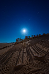 the long shadow (kisko-Sonia) Tags: wood shadow beach night stars noche madera sand nikon dunes playa arena cielo estrellas cadiz nocturna duna sombras tarifa valla valdevaqueros d7100