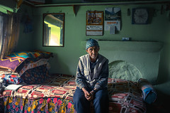 In my solitude (Camille Marotte) Tags: old travel windows light portrait house man mountains travelling art home window face 35mm turkey bed bedroom solitude alone natural poor sigma wise wrinkles turkish balikesir 2016 traditionnal 1dc camillemarotte