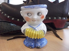 1st June 2016 (themostinept) Tags: china boy man shoe ornament clog concertina eggcup