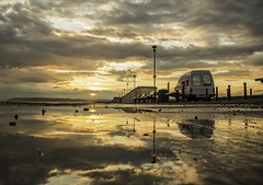 Puddle Reflections (Explore) (GPC- photos) Tags: blue sunset orange reflection beach water yellow clouds reflections sussex colours path huts explore van lowdown seaford explored canon700d
