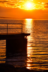 Sunset by the beach [Explored 2016-06-25] (Maria Eklind) Tags: bridge sunset red sea sky sun beach water yellow se outdoor dusk himmel serene sverige malm solnedgng swden resund sibbarp resundsbron skneln