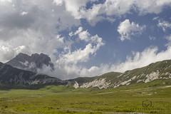 Maestoso (Lady.M.) Tags: road horses panorama mountain green nature clouds walking landscape strada nuvole natura tibet gran montagna cavalli paesaggio abruzzo laquila appennini gransasso sasso landscapephotography littletibet piccolotibet