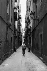 Lone walk (RB Pho-tog-raphy) Tags: barcelona street old summer blackandwhite bw white man black streets lines photography spain nikon streetphotography greyscale