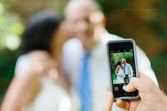 Smart phone used to take photo of a wedding couple (Robert Lang Photography) Tags: wedding people love hands hug technology phone tech cellphone cell gear celebration smartphone together mobilephone adelaide moment capture twopeople brideandgroom commitment blurrybackground takingaphoto capturethemoment glenewinestate robertlangphotography wwwrobertlangcomau robertlangaustralia robertlangsouthaustralia phoneatwedding takingaphotoofaweddingonasmartphone photoofbrideandgroom cellphoneusedtotakeweddingphoto