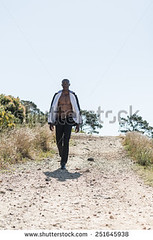 stock-photo-african-black-male-model-wearing-black-suit-with-white-unbuttoned-shirt-walking-down-gravel-path-251645938 (Soft Focus Photography) Tags: road white mountain man black sexy male men fashion businessman shirt modern standing dark walking person model open looking adult body path walk african background coat young formal handsome style professional business suit pack tuxedo american topless attractive elegant six toned success isolated unbuttoned gravel confident stylish