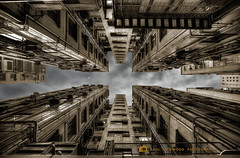 Things are looking up (Paul Hogwood Photography) Tags: windows sky silhouette night clouds hongkong apartments apartment flat pipes lookingup blocks block walls railing airconditioners units drainpipes silhoutted
