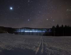 Skiing in Winter Wonderland (MilaMai) Tags: road nightphotography winter sky lake snow horizontal barn rural forest finland stars landscape outdoors frozen scenery skiing path hill snowdrift trails nopeople crosscountry planets dreamy nightsky lighttrails snowfield jupiter magical atmospheric snowscape starsky skitrack cartrails underthestars easternfinland milamai