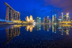 Marina Bay Singapore and its reflection (BP Chua) Tags: city travel blue sunset urban reflection water rain buildings wow landscape sony wideangle bluesky double cbd bluehour brilliant marinabay artscience goldcollection marinabaysands marinabaysingapore