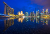 Marina Bay Singapore and its reflection [Explored] (BP Chua) Tags: city travel blue sunset urban reflection water rain buildings wow landscape sony wideangle bluesky double cbd bluehour brilliant marinabay artscience goldcollection marinabaysands marinabaysingapore ilce7