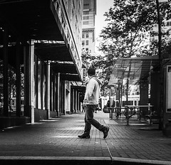 A Pedestrian's Gate (TMimages PDX) Tags: road street city people urban blackandwhite monochrome buildings portland geotagged photography photo image streetphotography streetscene sidewalk photograph pedestrians pacificnorthwest avenue vignette fineartphotography iphoneography