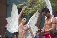 Leaving him hanging (quinn.anya) Tags: sunglasses smirnoff wings highfive angel phone distracted prideparade sfpride sfpride2016 pride