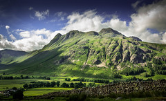 The Lake District in all it's beauty. (ian.emerson36) Tags: trees sunlight mountain beauty stone wall clouds canon landscape shadows stonework hill lakes lakedistrict cumbria vegetation greenery 1855mm langdale