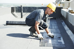 Flat roof covering works with roofing felt (roofingcompany) Tags: bitumenfelt ruberoid tarfelt roofingfelt tarpaper sheet roofingmembrane dampproofing waterproofing material flatroof roll roofing roofer specialist contractor laborer worker builder equipment constructionsite covering coating heating melt propanegas torchflame refurbishment new repair renewal protection recovering insulation repairman technology maintenance majoroverhaul installation technique building industry roof flexible