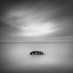 A rock (thomas bach nielsen) Tags: longexposure blackandwhite seascape beach rock strand denmark nikon danmark bnw nordjylland d80 nd110 strandby bwnd110 tokina1116mmf28