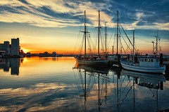 Halli (dubdream) Tags: sunset sea sky cloud sun seascape port germany boat nikon sailing ship harbour balticsea fishingboat hafen contrails ostsee schleswigholstein sailingboat calmsea heiligenhafen colorimage wetreflection d810 dubdream