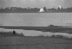 View Across Ayeyarwady River from U Bein's Bridge (Amarapura, Myanmar 1994) ((Woody Wood)) Tags: blackandwhite bw film landscape southeastasia burma archive myanmar amarapura ayeyarwadyriver ubeinsbridge
