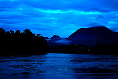 Mekong Blues (Manlio'77) Tags: blue sunset mountains nature water river landscape evening asia blues waters laos acqua impressive mekong luangprabang suggestive nightfall southasia