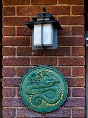 Dragon Disk (Kevin MG) Tags: ca usa green lamp sign dragon bricks disney amusementpark californiaadventures aneheim