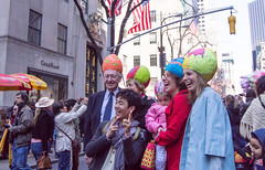 Selfie with the Eggheads (UrbanphotoZ) Tags: nyc newyorkcity baby ny newyork men women manhattan egg hats rockefellercenter midtown americanflags fifthave selfie eggheads easterparade colehaan