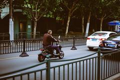On the Move (Sam Gu Wang) Tags: china street 35mm fuji shanghai f14 fujifilm   moped xe1
