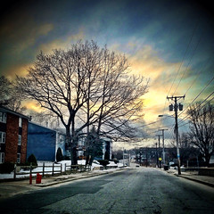 Street shot - Privilege St., Woonsocket, RI (Scorpiol13) Tags: road street city winter sunset sky usa snow tree skyline landscape driving apartments afternoon horizon sidewalk rhodeisland residential hdr barebranches woonsocket snowonground iphoneography iphone4s