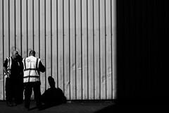 Onlooker (John M. Vaughan) Tags: street light shadow white black monochrome canon dark documentary belfast nireland 600d