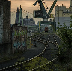 Always the summers are slipping away (creyesk) Tags: railroad sunset train wagon graffiti harbor cathedral cologne rails