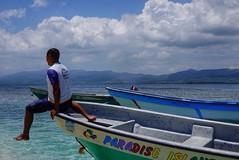 Boat Man at Cayo Arena (canaimaman) Tags: ocean blue boy sea sky man beach beautiful island boat tropical reef sonyrx10