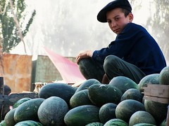 The young boy and the watermelons (__Thomas Tassy__) Tags: china asian asia watermelon kachgar kashgar xinjiang silkroad boy young portrait color travel market vendor street stunning great nice eye trip kodak