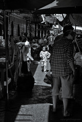 In a crowded place (FimRay) Tags: street people blackandwhite bw white black streets monochrome kids children asian thailand child market crowd markets monotone crowds traditionalstreet