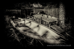 Awaiting (www.annmholmes.co.uk) Tags: eire europe boats kylemore abbey lough lake rowingboats connemara ireland irish nostalgia monochrome blackandwhite traditional oldfashioned