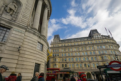 London, seen wide (Мaistora) Tags: life street city uk blue windows roof red england sky people urban sculpture white color colour bus london classic tourism station skyline architecture clouds strand buildings reflections underground southafrica gold golden cosmopolitan baker traffic metro britain traditional capital crowd tube decoration entrance culture trafalgar trafalgarsquare grand wideangle tourist flags embassy historic busy antelope routemaster colourful banners decor iconic protests thestrand passerby doubledecker mandela lu global apartheid tfl southafricahouse highcommission grandbuilding maistora a6000 ultraside yahoo:yourpictures=weather sel1018