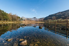 Lake District April 2015 156 - Tranquility - Langdale Pikes reflected in Blea Tarn (Mark Schofield @ JB Schofield) Tags: above blue light england sky woman mountains wet beautiful reflections dove seat lakes lakedistrict tranquility calm peat cumbria fells hart how horseshoe pike bog tarn crags sandal tranquil fairfield shaft langdale dovedale patterdale deepdale blea crag fellwalking englishlakes hartsop stsundaycrag grisedale cofa