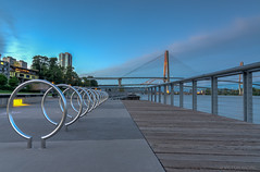 Keyhole bike racks on the boardwalk (maestro17ca) Tags: nightphotography bike architecture view britishcolumbia bridges skybridge quay boardwalk railing keyhole fraserriver newwestminster bikerack lowermainland greatervancouver patullobridge tokina1116mm28 nikond7000