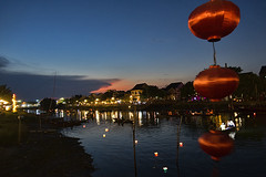 Lanterns in the breeze at sunset (ORIONSM) Tags: sunset water reflections river sony vietnam hoian lanterns bluehour swinging breeze rx100