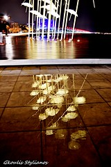 reflections (steliosgkoulis) Tags: water rain reflections greece macedonia umbrellas timeless makedonia