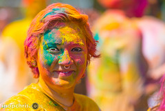 green and ornage covered girl (tibchris) Tags: california portrait people color festival spring indian vivid traditions powder covered stanford paloalto asha holi holifestival indianfestival gulal standfordholi ashaholifestival